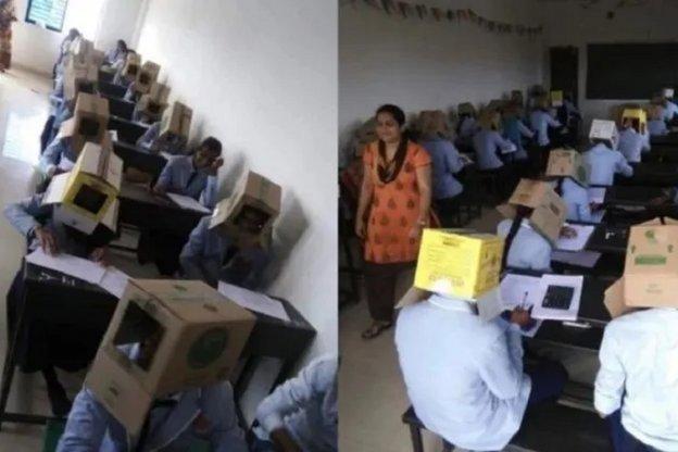 Le pidió a sus alumnos que hagan la prueba con cajas en la cabeza para que no se copien